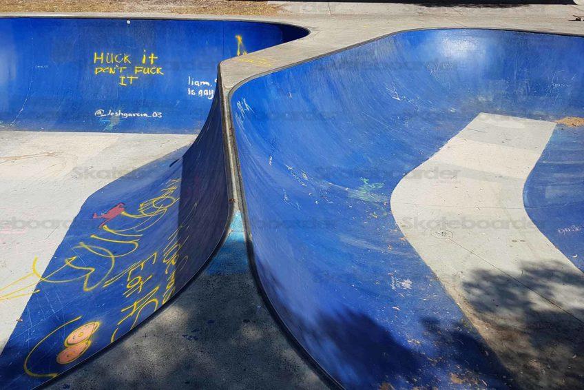 Spine between skate bowls